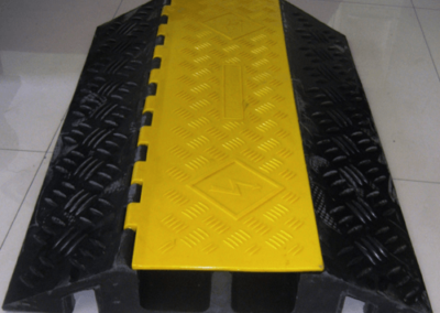 Yellow elevated jacket cable protectors – used for pedestrian traffic 3' long