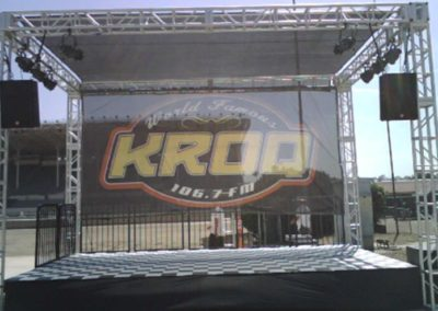 16'W x 32'L x 15'H high truss structure (four towers) with scrim shade roof & black scrim backdrop